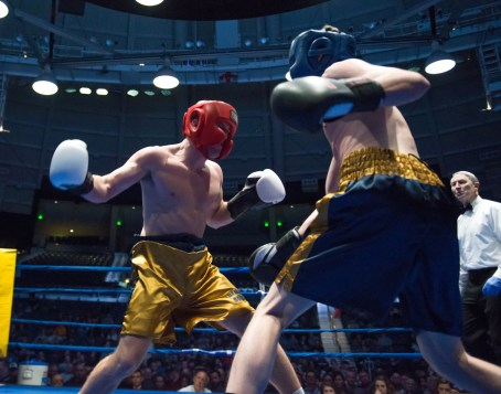 Brendan Lesch (blue) vs. Jason Ellinwood (gold). Michael Yu   The Observer