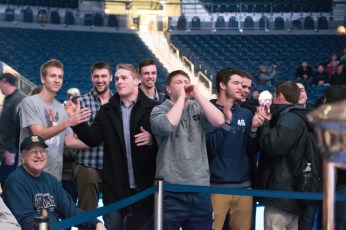 """Irish linebacker Joe Schmidt (fourth from left) cheers on his former teammate Tyler """"Tuna"""" Plantz as he fights Jackson """"The Flash"""" Wrede. Michael Yu   The Observer"""