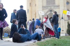 A visitor takes a picture of The Basilica of the Sacred Heart as they wait to enter the Paschal Vigil Mass on Satuday.