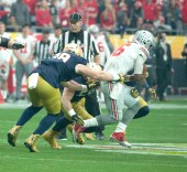 Irish sophomore defensive lineman Andrew Trumbetti tackles Ohio State sophomore quarterback J.T. Barrett during Notre Dame's 44-28 loss to the Buckeyes on Friday in the Fiesta Bowl in Glendale, Arizona.