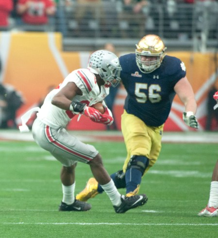 Irish sophomore offensive lineman Quenton Nelson bears down for a tackle after an interception by Buckeyes graduate student cornerback Tyvis Powell during Notre Dame's 44-28 loss to Ohio State.