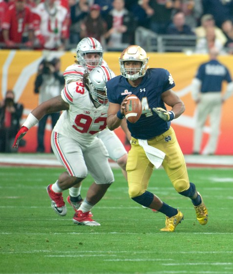 Irish sophomore quarterback DeShone Kizer scrambles and looks to pass during Notre Dame's 44-28 defeat to Ohio State in the Fiesta Bowl on Friday at University of Phoenix Stadium in Glendale, Arizona.