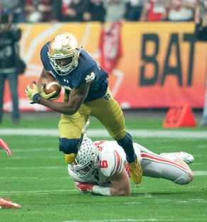 Irish freshman running back Josh Adams charges forward during Notre Dame's 44-28 loss to Ohio State on Friday in the Fiesta Bowl. Adams led Notre Dame with 78 rushing yards and one touchdown.