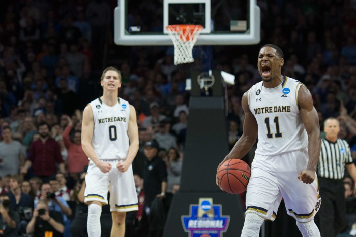 Junior forward Demetrius Jackson, right, celebrates near the conclusion of Notre Dame's 61-56 NCAA tournament win over Wisconsin on Friday at Wells Fargo Center in Philadelphia.