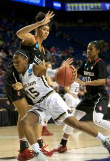 Irish junior guard Lindsay Allen fights her way through traffic during Notre Dame's 90-84 loss to Stanford in the Sweet 16 on Friday night.