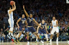 Junior forward V.J. Beachem, center, closes out during Notre Dame's 88-74, season-ending loss to North Carolina on Sunday.