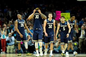 Notre Dame players look on dejectedly as the final seconds wind down of their 88-74 loss to North Carolina on Sunday in the Elite Eight.