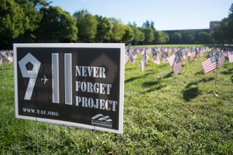 American flags stand next to the South Quad flag pole on September 11, 2016. Notre Dame partnered with the Never Forget Project to hold a prayer service and memorial in remembrance of those who lost their lives in the 9/11 terrorist attacks 15 years ago.