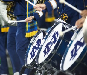 The Notre Dame drumline performs on the sidelines at the football game on Saturday.