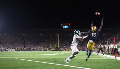Sr. Torii Hunter Jr leaps in attempt to catch a touchdown pass.