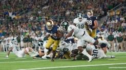 Sr. Tarean Folston evades a tackle from Michigan State's denfense