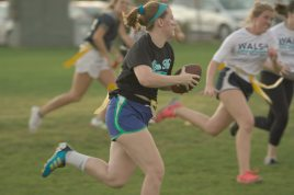 A member of the Ryan Hall flag football team runs down the field during their game against Walsh Hall.