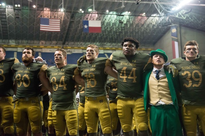 Notre Dame players sing the Alma Mater with the Leprechaun after Notre Dame's win over Army.