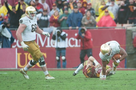 Irish junior quarterback Deshone Kizer is brought down by a USC defender after completing a pass during Saturday's 45-27 loss to the Trojans.