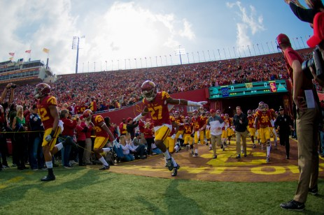Redshirt sophomore defensive back Ajene Harris leads the Trojans out on to the field prior to Saturday's game against Notre Dame.