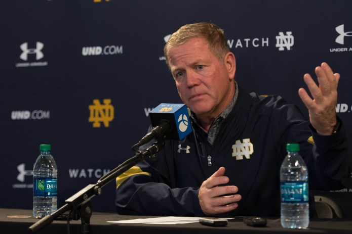 Brian Kelly addresses the media following Notre Dame's 45-27 loss to USC on Nov. 26, 2016, at Los Angeles Memorial Coliseum.