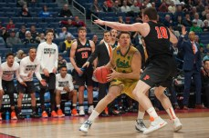 Irish sophomore forward Matt Ryan tries to evade a Princeton defender during Thursday's 60-58 first-round win over Princeton in Buffalo, New York.