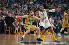 Irish junior guard Matt Farrell tries to spin past a West Virginia defender during Satuday's 81-73 second-round loss to West Virginia in Buffalo, New York.