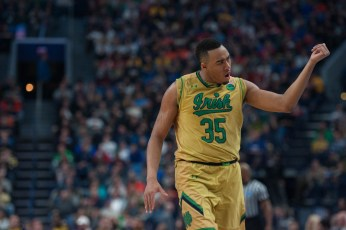 Irish junior forward Bonzie Colson implores the Irish crowd to cheer during Notre Dame's 83-71 loss to West Virginia on Saturday at KeyBank Arena.