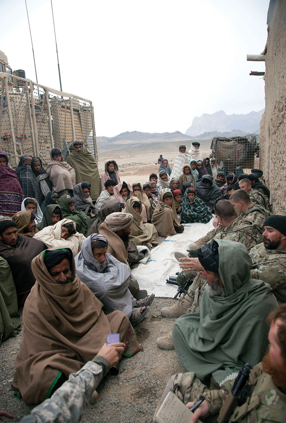 Soldiers from Charlie Troop, 2-38 Cavalry, and DA civilians, Human Terrain System, with local Afghan villagers during Key Leader Engagement in Kandahar Province (DOD/Crystal Davis)