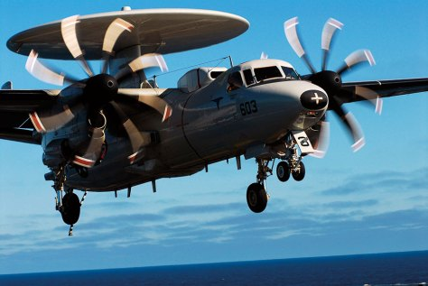 """U.S. Navy E-2C Hawkeye 2000 aircraft assigned to """"Wallbangers"""" of Carrier Airborne Early Warning Squadron 117 approaches flight deck of USS John C. Stennis while ship is underway in Pacific Ocean, July 13, 2006 (DOD/John Hyde)"""