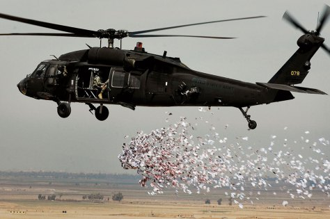 Soldiers from U.S. Army's 350th Tactical Psychological Operations, 10th Mountain Division, drop leaflets over village near Hawijah, Iraq, on March 6, 2008, promoting idea of self-government (U.S. Air Force/Samuel Bendet)