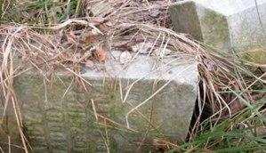 Downed gravestones in an Etowah County, AL cemetery.