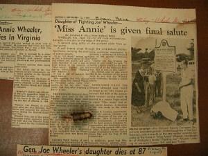 Newspaper clippings shelftop.