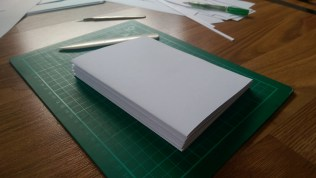 The paper has been separated into 8 sheets and folded into signatures. A bone folder comes in very handy for this - it can be quite hard to get a precise fold otherwise.