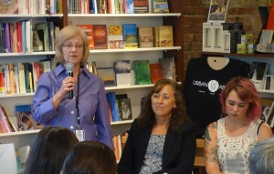 Mary Raynovich (left) of the Salvation Army's Wellspring Program, talks to the crowd about working with trafficking survivors.