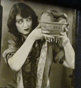 Eve Southern was an American film actress and a Hollywood film star. In the photo, she is holding a pot written on it, Golden Rule.
