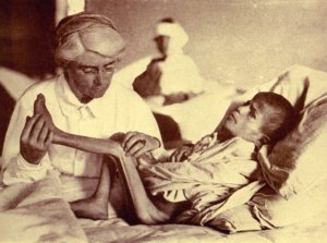 Dr. Mabel Elliott with an emaciated young patient. Many children arrived at the orphanages suffering from severe malnutrition.