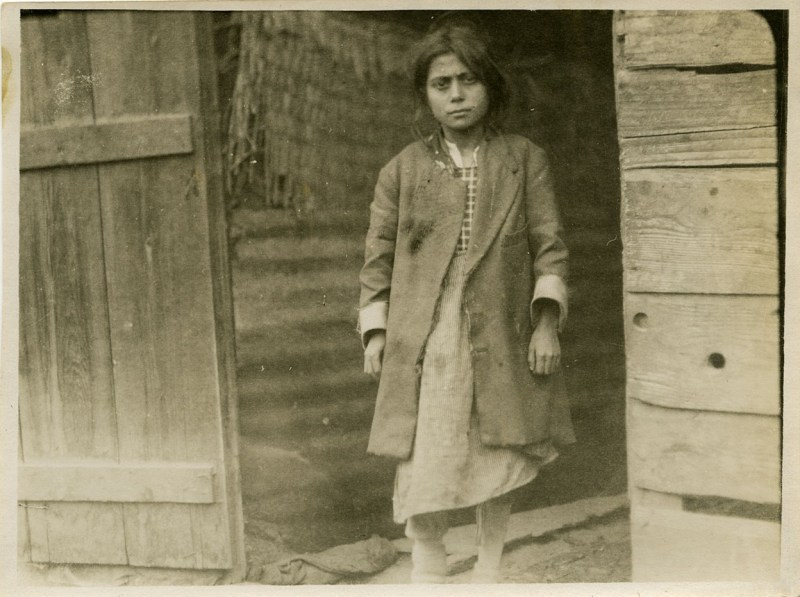 Refugee girl in a doorway