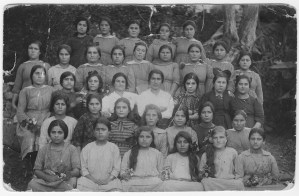 Group of girls at Ghazir Orphanage, which was famous for its handwoven carpets. Gift of Victoria Chadrijian Palian. Victoria is seated in the front row at the far right.