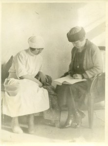 Student nurse with female relief worker.