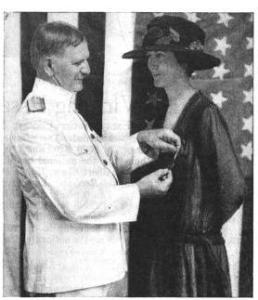 A relief worker receives a medal