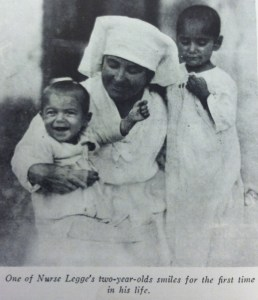 Nurse Gertrude Legge with children. This photograph was used in a letter campaign.