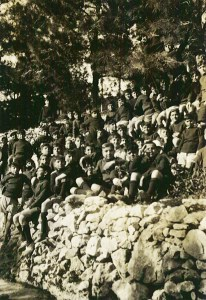 A group of boys pose on a hillside at Syra Orphanage. The orphanage housed 3,000 boys and girls and included an agricultural school.