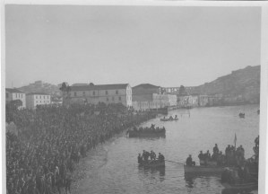 A massive crowd of men on the shoreline at Kavalla, Greece. The men were probably involved in a Christian religious ceremony that reenacts the baptism of Jesus Christ.