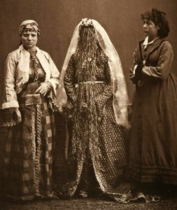 Studio portrait of an Armenian bride, Jewish woman, and a young Greek girl