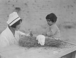 Nurse and child with a rabbit at the orphanage complex at Alexandropol. The young woman may be a student or graduate of the Edith Winchester Nursing School.