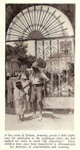 A boy scout greets a small child outside Erivan orphanage.
