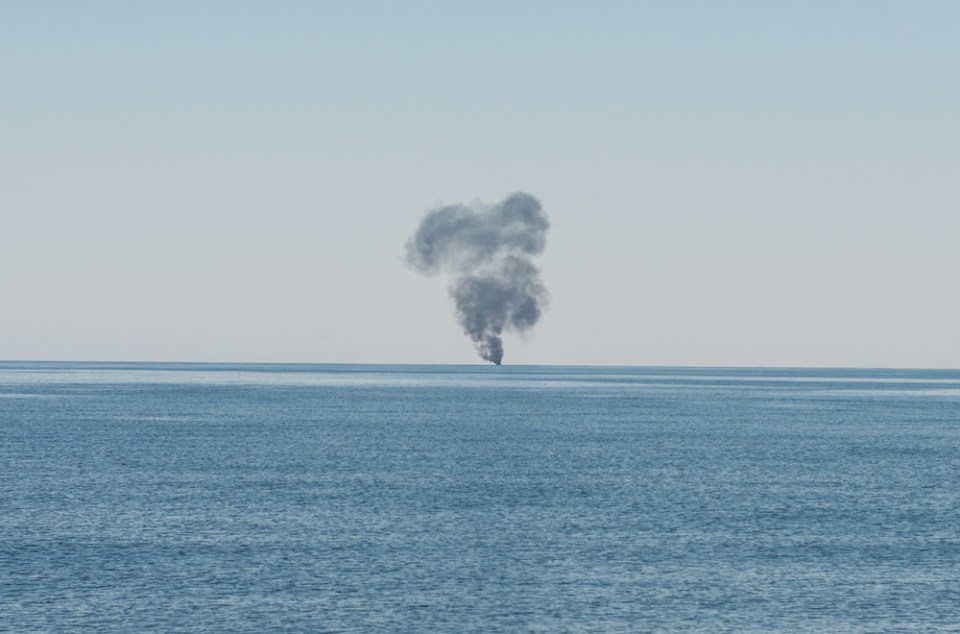 After a rescue operation is complete, the migrants' boat is blown up by a nearby military vessel. (MSF)