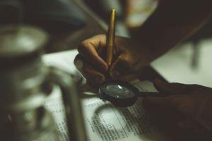 entering accounting data ledger book fountain pen