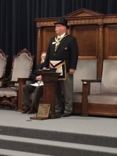 Grand Master Dennis E. Rix addressing Hastings Lodge No. 50 after being received in proper form.
