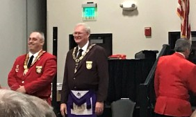 Most Excellent Grand High Priest (and Personal Representative of the Grand Master) A J Johnson and Most Illustrious Carl Plants greet attendees at Grand York Rite on April 7 in Kearney.