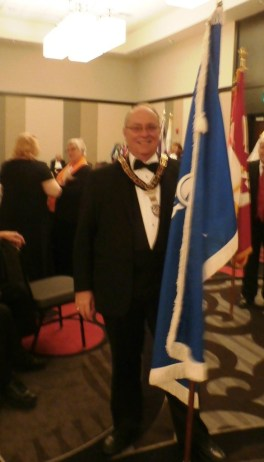 MW Rick Myers with the Masonic flag prior to Flag Tribute at the informal opening of the 142nd annual Session of Nebraska Grand Chapter Order of the Eastern Star.