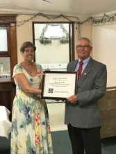 The presentation was of a Non-Masonic Achievement Award was made to Beverly J. McNiff as she retires from a 23-year career in the local Mid-Nebraska Community Services. She was accompanied by husband Richard. Left, Beverly J. McNiff receiving a Recognition Plaque from WM Ingram.