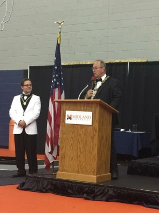 Grand Master brings greetings to Demolay Conclave. At left is State Master Counselor Brother Dakota Wells.