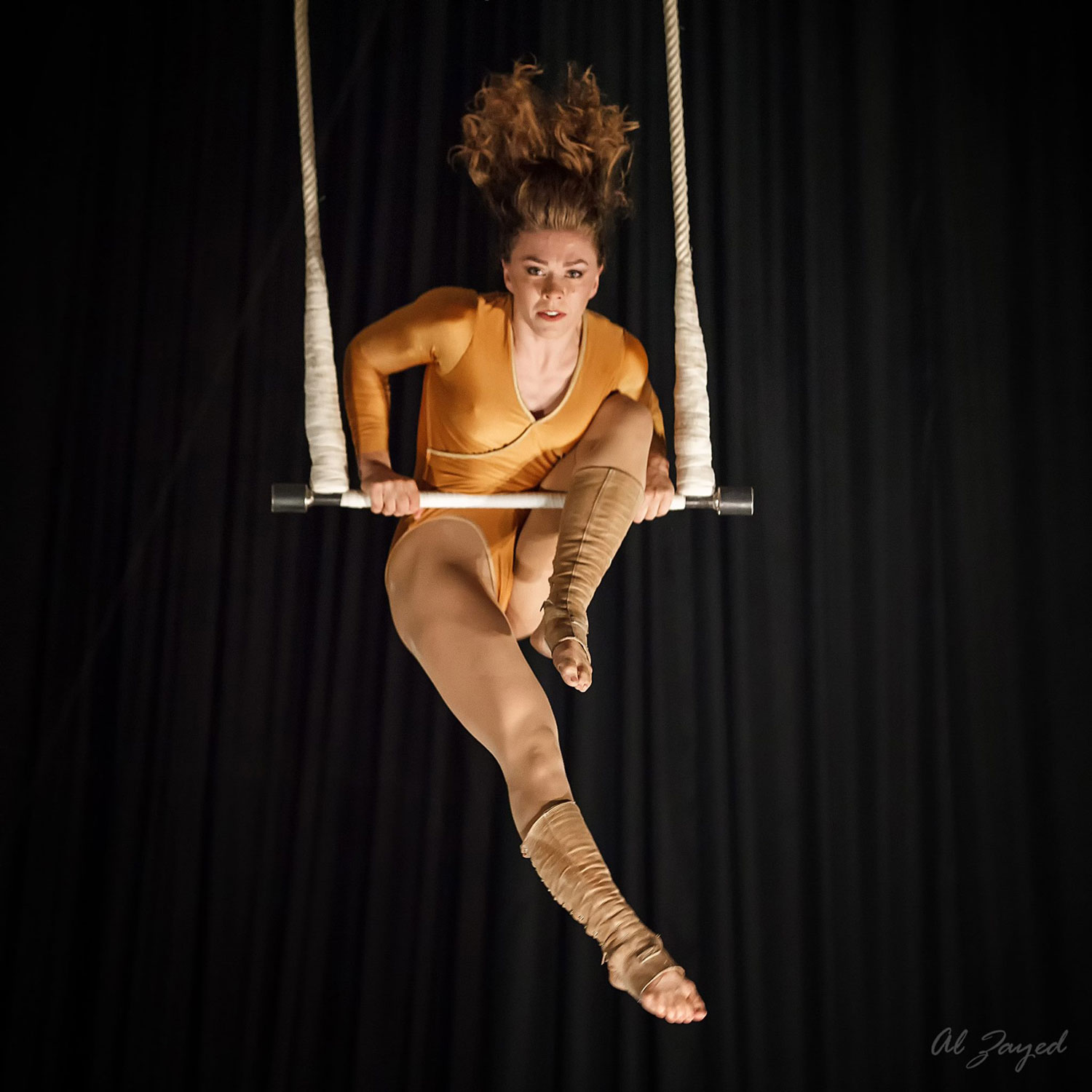 photo of Catherine Jett, NECCA Coach, performing on Trapeze
